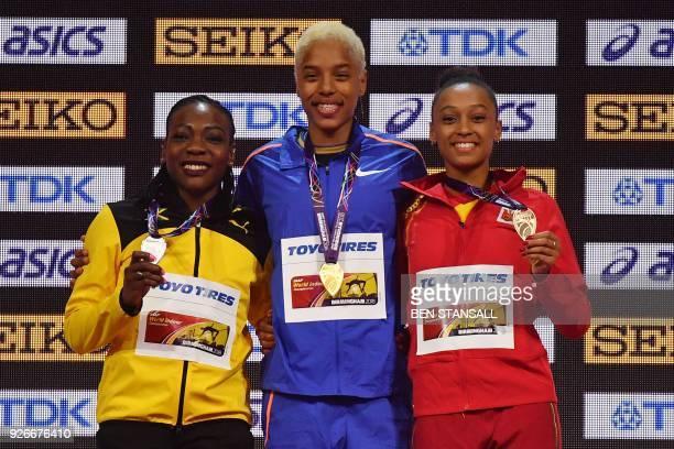 Silver medallist Jamaica's Kimberly Williams gold medallist Venezuela's Yulimar Rojas and bronze medallist Spain's Ana Peleteiro pose on the podium...