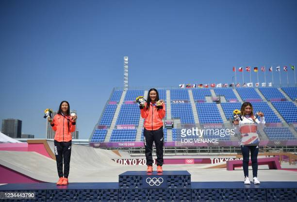 Silver medallist Japan's Kokona Hiraki, gold medallist Japan's Sakura Yosozumi and bronze medallist Britain's Sky Brown pose on the podium of the...