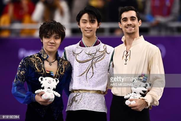 Silver medallist Japan's Shoma Uno gold medallist Japan's Yuzuru Hanyu and bronze medallist Spain's Javier Fernandez celebrate during the victory...