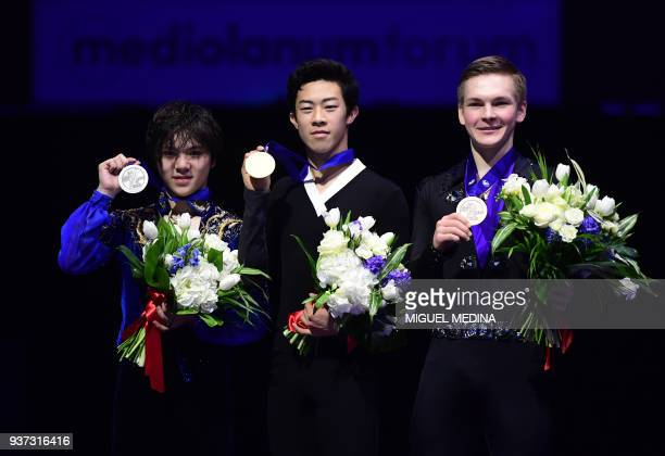 Silver medallist Japan's Shoma Uno gold medallist US Nathan Chen and bronze medallist Russia's Mikhail Kolyada pose on the podium of the MenFree...