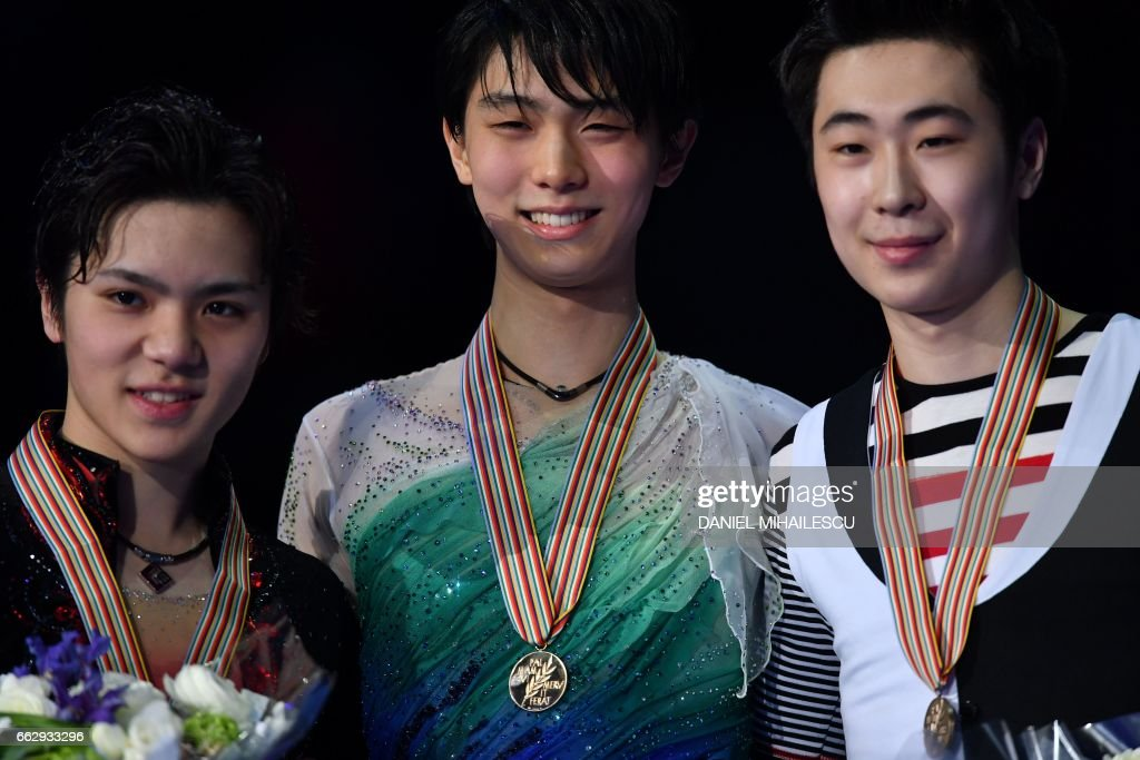 Silver medallist Japans's Shoma Uno, Gold medallist Japan's Yuzuru Hanyu and Bronze medallist Boyan Jin of China pose after the men's free skating event at the ISU World Figure Skating Championships 2017 in Helsinki April 1, 2017. / AFP PHOTO / Daniel MIHAILESCU