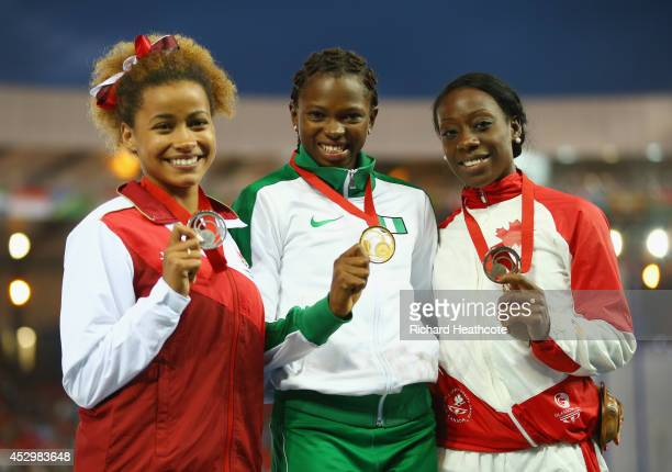 Silver medallist Jazmin Sawyers of England gold medallist Ese Brume of Nigeria and bronze medallist Christabel Nettey of Canada pose on the podium...