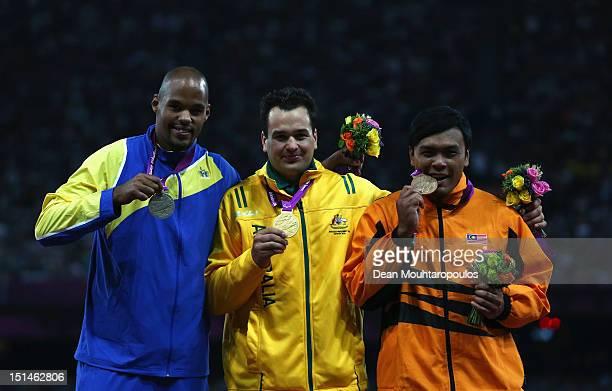 Silver medallist Jeffrey Ige of Sweden gold medallist Todd Hodgetts of Australia and bronze medallist Muhammad Ziyad Zolkefli of Malaysia pose on the...