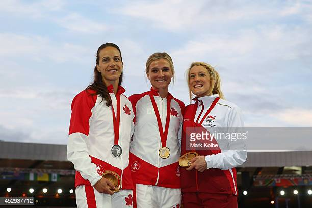 Silver medallist Jessica Zelinka of Canada, gold medallist Brianne Theisen-Eaton of Canada and bronze medallist Jessica Taylor of England pose on the...