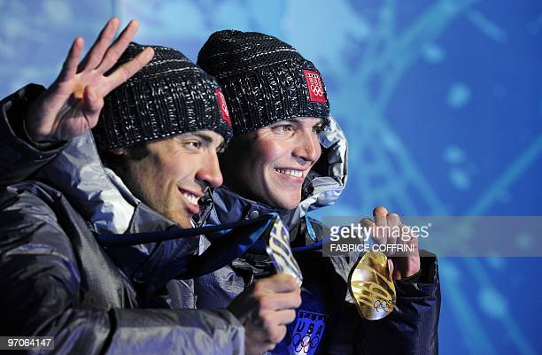 US Silver medallist Johnny Spillane and US Gold medallist Bill Demong are seen during the medal ceremony for the Nordic combined Long Hill/ 10km...