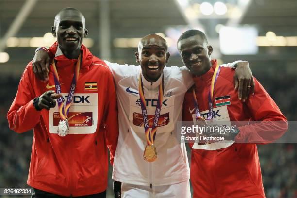 Silver medallist Joshua Kiprui Cheptegei of Uganda gold medallist Mo Farah of Great Britain and bronze medallist Paul Kipngetich Tanui of Kenya pose...