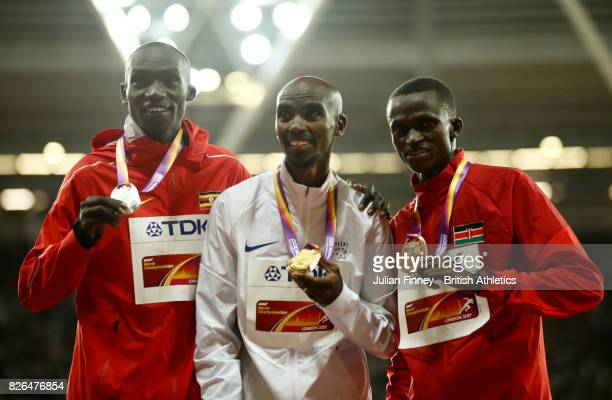 Silver medallist Joshua Kiprui Cheptegei of Uganda gold medallist Mo Farah of Great Britain and bronze medallist Paul Kipngetich Tanui of Kenya pose...