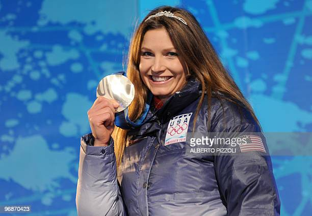 US silver medallist Julia Mancuso stands on the podium during the medal ceremony for the Alpine skiing Ladies Super combined event of the Vancouver...