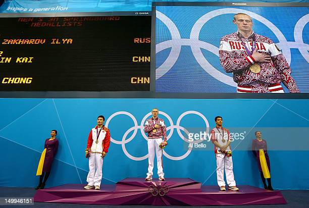 Silver medallist Kai Qin of China gold medallist Illya Zakharov of Russia and bronze medallist Chong He of China pose on the podium during the medal...