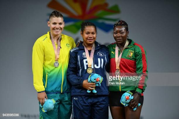 Silver medallist Kaity Fassina of Australia gold medallist Eileen Cikamatana of Fiji and bronze medallist Clementine Meukeugni Noumbissi of Cameroon...