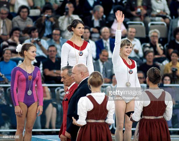 Silver Medallist Karin Janz of East Germany Gold Medallist Ludmilla Tourischeva of Russia and Bronze Medallist Tamara Lazakovich of Russia during the...