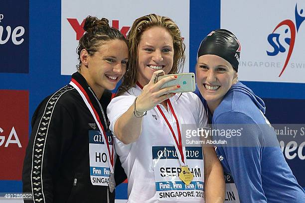 Silver medallist Katinka Hosszu of Hungary Gold medallist Emily Seebohm of Australia and Bronze medallist Missy Franklin of United States of America...