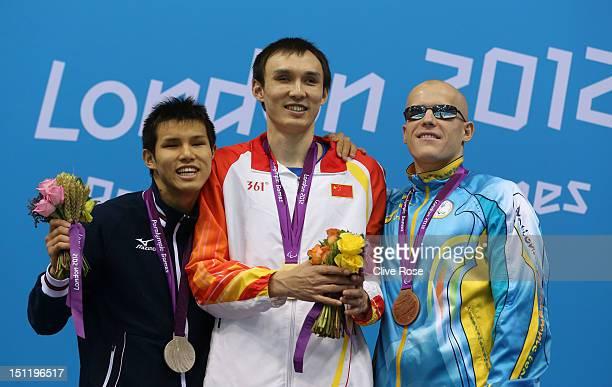 Silver medallist Keiichi Kimura of Japan gold medallist Bozun Yang of China and bronze medallist Oleksandr Mashchenko of Ukraine pose on the podium...