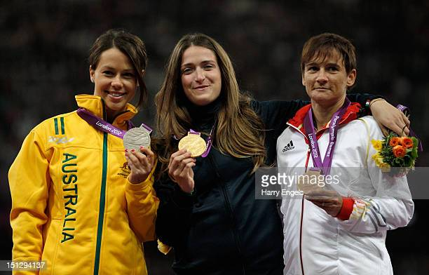 Silver medallist Kelly Cartwright of Australia gold medallist Martina Caironi of Italy and bronze medallist Jana Schmidt of Germany pose on the...