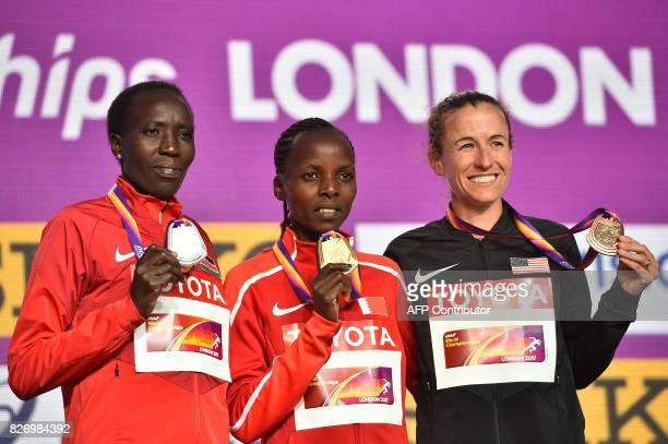 Silver medallist Kenya's Edna Ngeringwony Kiplagat Gold medallist Bahrain's Rose Chelimo and bronze medallist US athlete Amy Cragg take part in a...