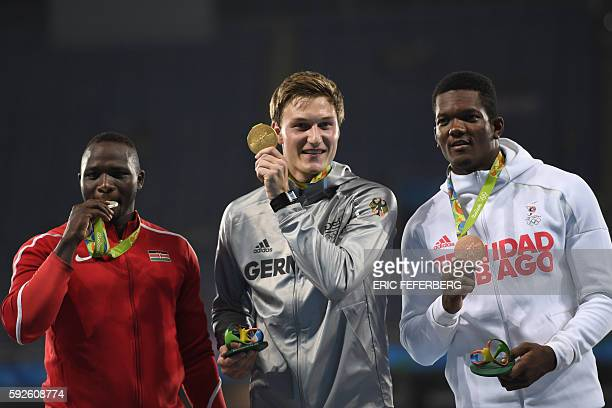 Silver medallist Kenya's Julius Yego, Gold medallist Germany's Thomas Rohler, and bronze medallist Trinidad and Tobago's Keshorn Walcott celebrate on...
