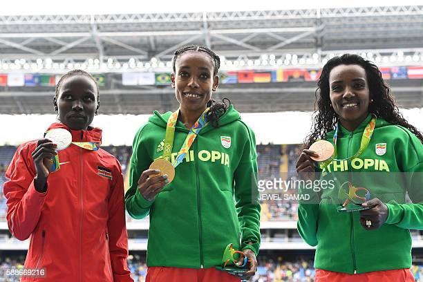Silver medallist Kenya's Vivian Jepkemoi Cheruiyot , Gold medallist Ethiopia's Almaz Ayana , and Bronze medallist Ethiopia's Tirunesh Dibaba pose for...