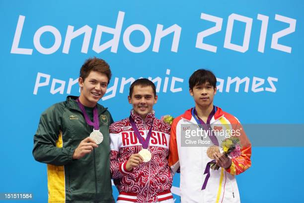 Silver medallist Kevin Paul of South Africa gold medallist Pavel Poltavtsev of Russia and bronze medallist Furong Lin of China pose on the podium...