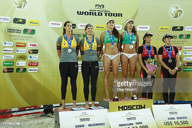 Silver medallist Kira Walkenhorst and Laura Ludwig of Germany, gold medallists Carolina Solberg Salgado and Maria Clara Salgado Rufino of Brazil,...