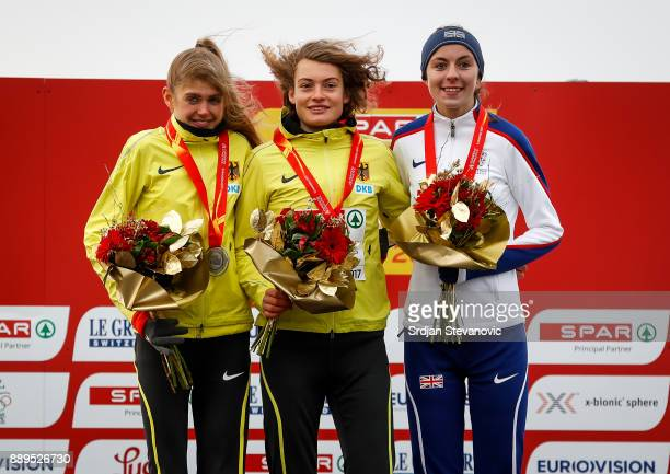 SIlver Medallist Konstanze Klosterhalfen of Germany Gold Medalist Alina Reh of Germany and Bronze Medalist Jessica Judd of Great Britain pose during...