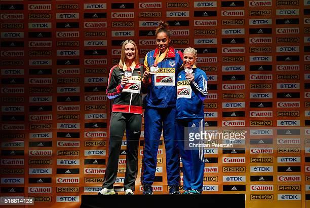 Silver medallist Kristin Gierisch of Germany gold medallist Yulimar Rojas of Venezuela and bronze medallist Paraskeví Papahrístou of Greece pose on...