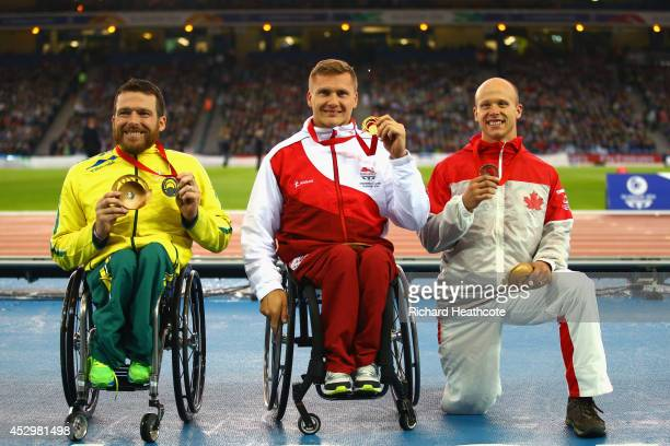 Silver medallist Kurt Fearnley of Australia gold medallist David Weir of England and bronze medallist Alex Dupont of Canada pose on the podium during...
