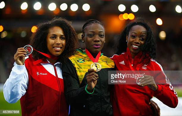 Silver medallist Laura Samuel of England, Gold medallist Kimberly Williams of Jamaica and bronze medallist Ayanna Alexander of Trinidad and Tobago...