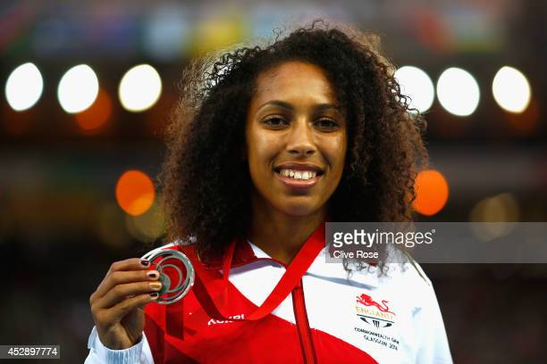Silver medallist Laura Samuel of England poses on the podium during the medal ceremony for the Women's Triple Jump at Hampden Park during day six of...
