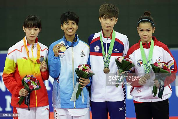 Silver medallist Li Zhao Yi of China gold medallist Chanatip Sonkham of Thailand and bronze medallist Sun Nuei Ning of Chinese Taipei and Levita...