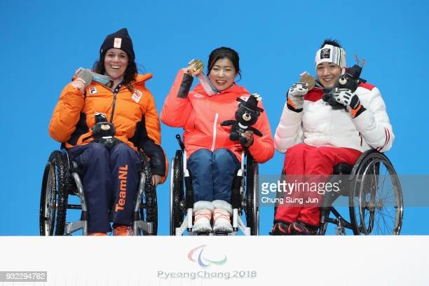 Silver medallist Linda van Impelen of the Netherlands Gold medallist Momoka Muraoka of Japan and Bronze medallist Claudia Loesch of Austria celebrate...