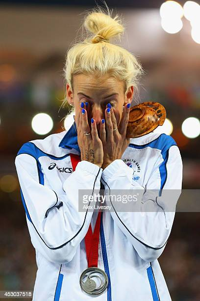 Silver medallist Lynsey Sharp of Scotland shows her emotions on the podium during the medal ceremony for the Women's 800 metres at Hampden Park...