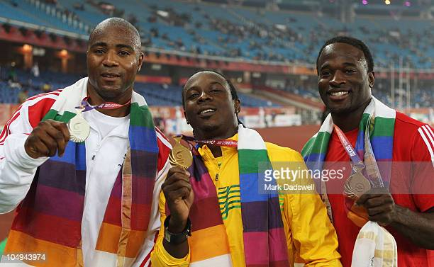 Silver medallist Mark LewisFrancis of England gold medallist Lerone Clarke of Jamaica and bronze medallist Aaron Armstrong of Trinidad and Tobago...