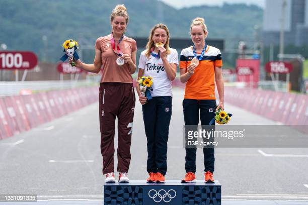 Silver medallist Marlen Reusser of Team Switzerland, gold medallist Annemiek van Vleuten of Team Netherlands and bronze medallist Anna van der...