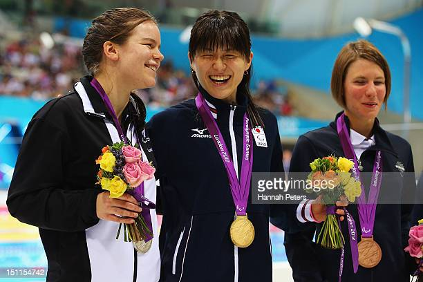 Silver medallist Mary Fisher of New Zealand gold medallist Rina Akiyama of Japan and bronze medallist Cecilia Camellini of Italy pose on the podium...