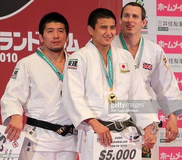 Silver medallist Masahiro Takamatsu gold medallist Takahiro Nakai and bronze medallist Leandro Guilheiro pose on the podium at the medal ceremony for...