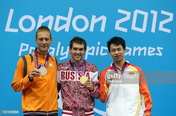 Silver medallist Maurice Deelen of Netherlands gold medallist Denis Tarasov of Russia and bronze medallist Yinan Wang of China pose on the podium...