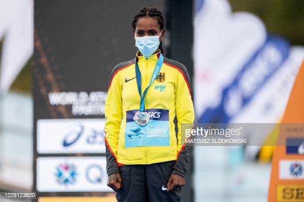 Silver medallist Melat Yisak Kejeta of Germany stands on the podium after the women's race of the 2020 IAAF World Half Marathon Championships in...