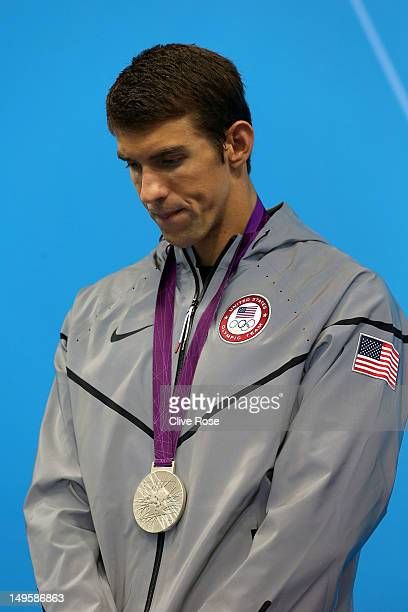 Silver medallist Michael Phelps of the United States poses on the podium during the medal ceremony for the Men's 200m Butterfly final on Day 4 of the...