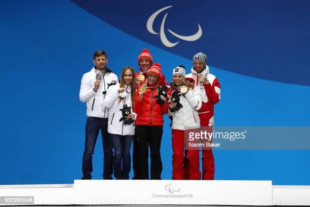 Silver Medallist Mikhalina Lysova of Neutral Paralympic Athlete Gold Medallist Sviatlana Sakhanenka of Beralus and Bronze Medallist Carina Edlinger...