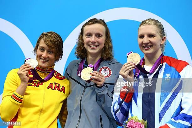Silver medallist Mireia Belmonte Garcia of Spain, gold medallist Katie Ledecky of the United States, and bronze medallist Rebecca Adlington of Great...