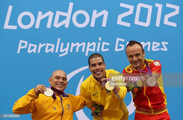 Silver medallist Moises Fuentes Garcia of Columbia gold medallist Daniel Dias of Brazil and bronze medallist Ricardo Ten of Spain pose on the podium...