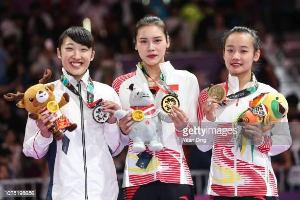 Silver medallist Mori Hikaru of Japan, gold medallist Liu Lingling of China and bronze medallist Zhu Shouli of China pose for photo during Gymnastics...