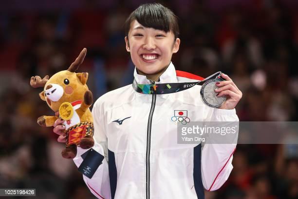 Silver medallist Mori Hikaru of Japan poses for photo during Gymnastics Women's Trampoline medal ceremony at JKT International EXPO on day twelve of...