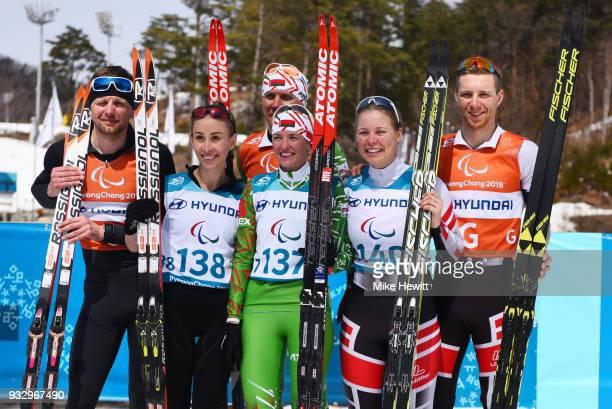 Silver medallist Mykhalina Lysova and guide Alexey Ivanov Gold medallist Sviatlana Sakhanenka of Belarus and guide Raman Yashchanka and Bronze...