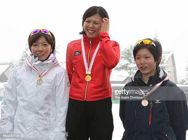 Silver medallist Nao Kodaira gold medallist Maki Tsuji and bronze medallist Miho Takagi pose on the podium at the medal ceremony for the Women's 500m...
