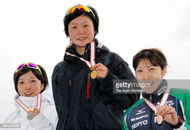 Silver medallist Nao Kodaira gold medallist Miho Takagi and bronze medallist Yukana Nishina pose on the podium at the medal ceremony for the Women's...