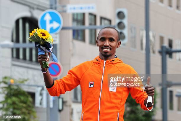Silver medallist Netherlands' Abdi Nageeye poses during an arrival ceremony after the men's marathon final during the Tokyo 2020 Olympic Games in...