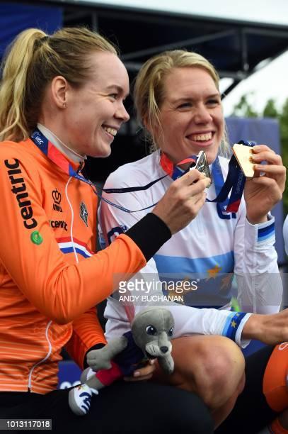 Silver medallist Netherlands' Anna Ven Der Breggen and gold medallist Netherlands' Ellen Van Dijk pose on the podium during the medal ceremony for...