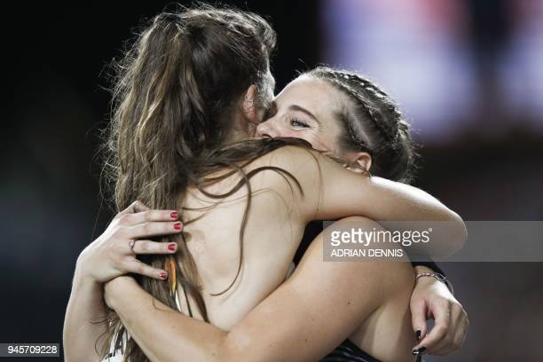 Silver medallist New Zealands Eliza McCartney celebrates with gold medallist Canadas Alysha Newman after the athletics women's pole vault final...