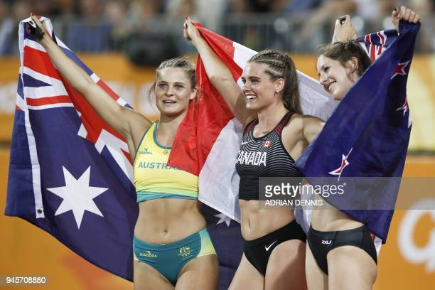Silver medallist New Zealands Eliza McCartney gold medallist Canadas Alysha Newman and bronze medallist Australias Nina Kennedy celebrate after the...